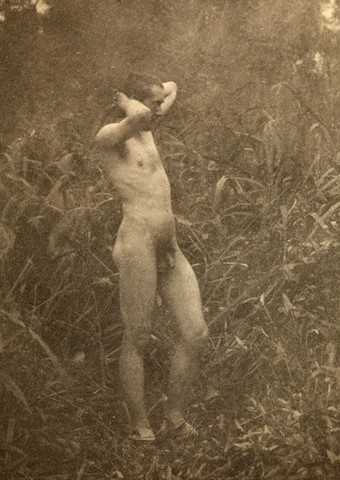 Thomas Eakins.1844-1916. Posing before his own camera in a leafy setting in the 1880s.